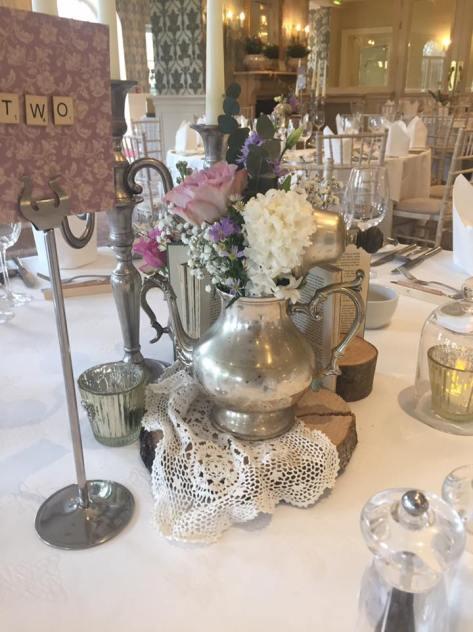 the vintage wedding fairy - step house hotel table decor